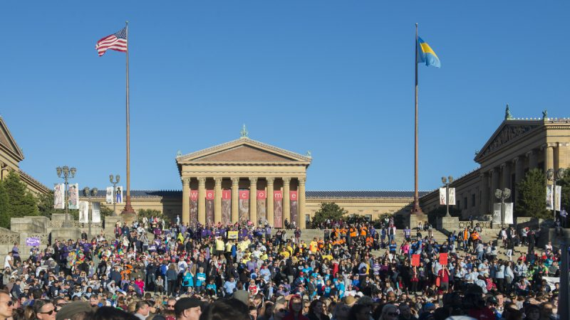 A mass of colorful groups take over the Art Museum steps