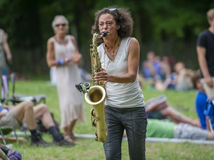Vanessa Collier stepped off the stage into the audience wailing on her saxophone. (Jonathan Wilson for WHYY)