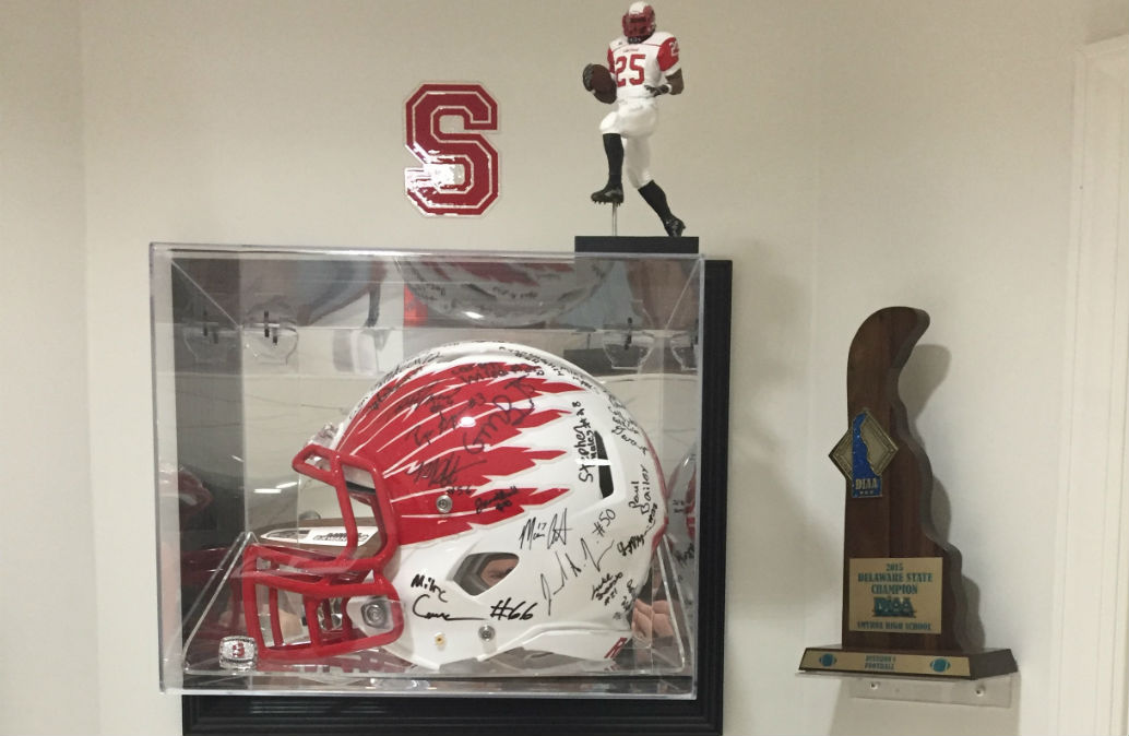 Former Smyrna player Tom Sayers, who runs his family's downtown jewelry store, is a big booster of the team and keeps memorabilia in his home. (Courtesy of Tom Sayers)