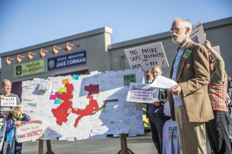 Advocates supporting the lawsuit that eventually overturned the state's congressional map rallied outside Senate Majority Leader Jake Corman's office in Centre County in October 2017.  (Min Xian/Keystone Crossroads)