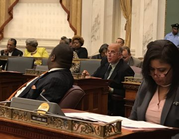 Philadelphia Councilman Mark Squilla (second from right) speaks with a colleague at a City Council session Thursday. (Joel Wolfram/for WHYY)
