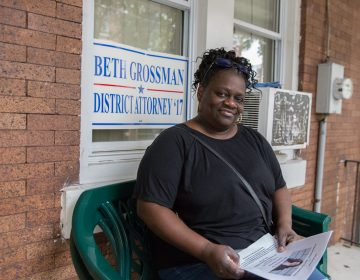 Daphne Goggins sits on her front porch in North Philadelphia in a 2017 file photo. She had been campaigning for Republican District Attorney candidate Beth Grossman. (Lindsay Lazarski/WHYY)