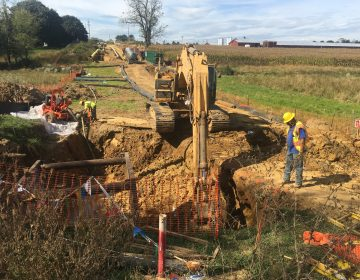 A backhoe digs a path for a pipeline in Pennsylvania