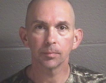 This undated photo provided by the Buncombe County Detention Center shows Michael Christopher Estes, who's accused of planting an improvised explosive device at the airport on Friday, Oct. 6, 2017, in Asheville, N.C.