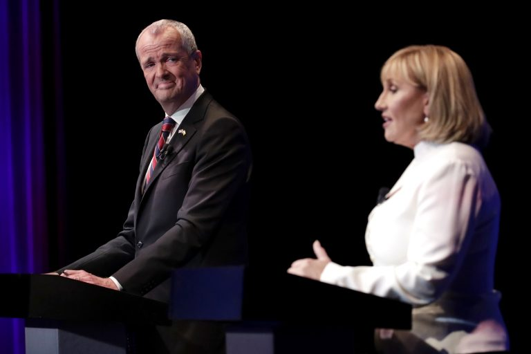 Democratic nominee Phil Murphy (left) listens as Republican nominee Lt. Gov. Kim Guadagno (right) answers a question during a gubernatorial debate at the New Jersey Performing Arts Center, Tuesday, Oct. 10, 2017, in Newark, N.J.