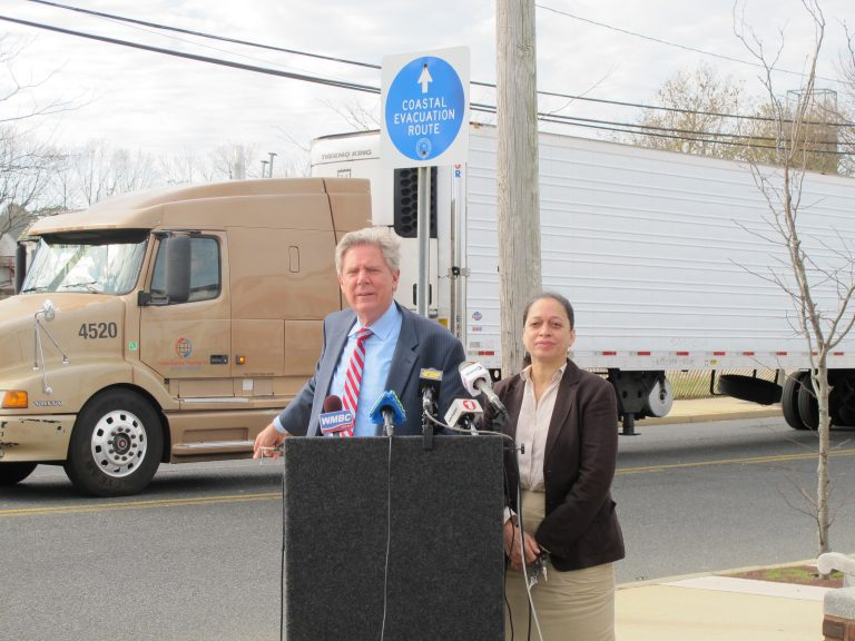 U.S. Rep. Frank Pallone, D-New Jersey,,  and Beverly Brown Ruggia with New Jersey Citizen Action say price gouging after a natural disaster is despicable. (Phil Gregory/WHYY)