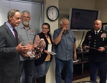 U.S. Senator Tom Carper, D-Del, presented the family of the late Private First Class James Davis, Jr. with the Bronze Star and Purple Heart Medals for Davis' service in the Army. From left: Senator Carper, James Davis, IV, Tina Davis, James Davis, III, and Command Sergeant Major Donald Catalon.  (Provided)