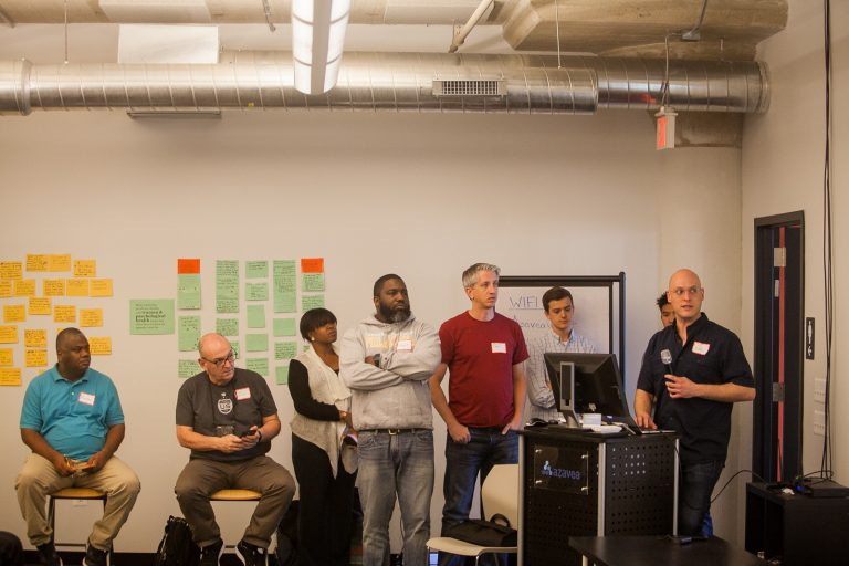 Teams presented their ideas to use technology to help formerly incarcerated people return to their communities at a 'hackathon' in Philadelphia organized by The Reentry Project. (Brad Larrison for WHYY)