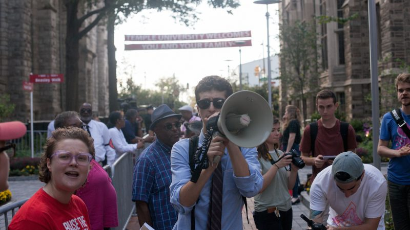 A man with a megaphone during a protest at Temple University