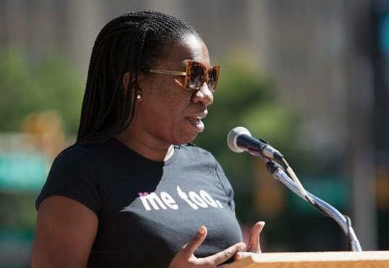 A woman in a black tshirt that reads