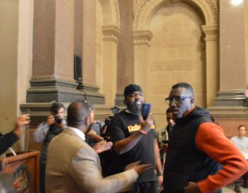 Black Lives Matter activist Asa Khalif (right) takes Philadelphia Councilman Curtis Jones from simulation to real life at City Hall Tuesday.
