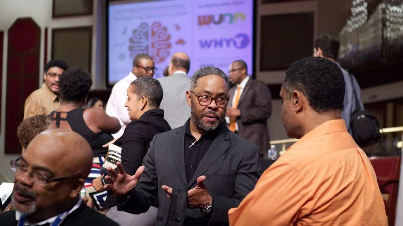 Rev. Dr. Alyn Waller, Pastor at Enon Tabernacle Baptist Church mingles after the forum concludes. (Bastiaan Slabbers for WHYY)