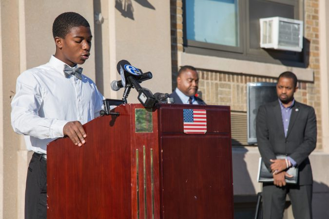 A boy speaks at a podium