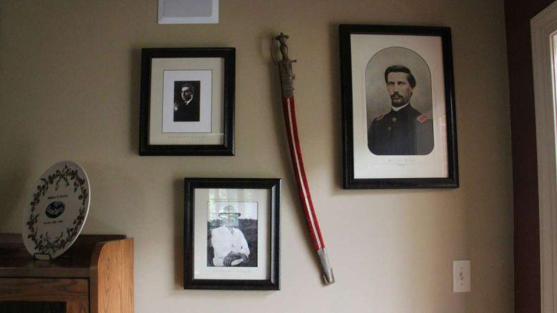 Historic photos hang on a wall
