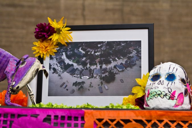 An image from Hurricane Harvey's flooding is displayed on the 2017 Day of the Dead Altar at the Penn Museum. (Kimberly Paynter/WHYY)