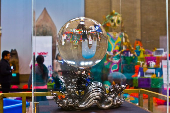 The Day of the Dead altar reflects through the Crystal Sphere on display at the Penn Museum. (Kimberly Paynter/WHYY)