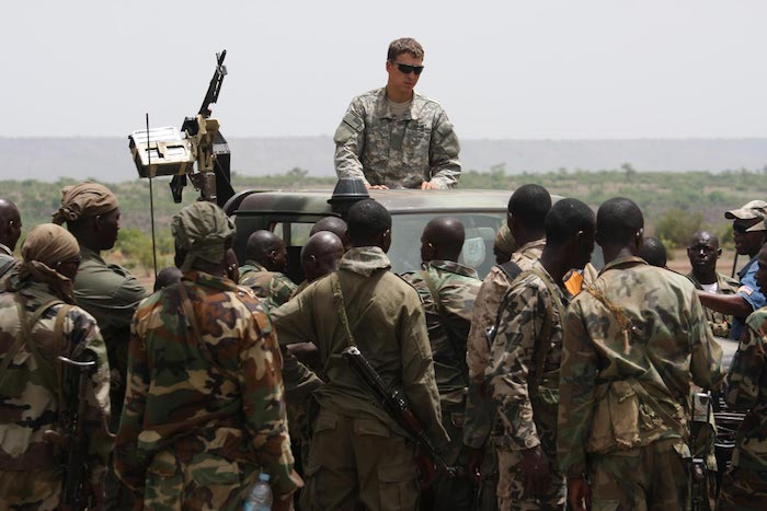 Malian special forces listen to instructions from a US Special Forces soldier on counter-ambush tactics in Kita, Mali, during a joint training exercise. (AP Photo / Alfred de Montesquiou)
