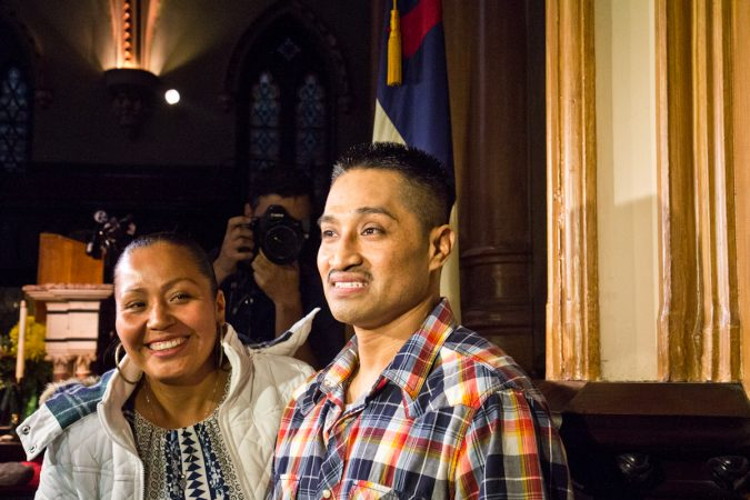 Javier Garcia Flores and his wife, Alma, wait inside the sanctuary of the First United Methodist Church on Arch Street in Philadelphia, before Flores will take his first steps outside the church since November of 2016. (Kimberly Paynter/WHYY)