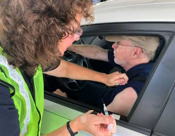 Hundreds of drivers got their flu vaccine at a drive-through clinic in Dover in October. (Kyle Bressler/WHYY)