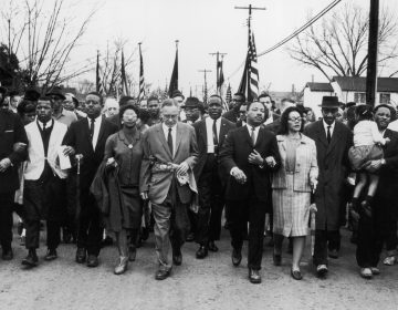 Civil rights leader Rev. Martin Luther King Jr. and his wife Coretta Scott King lead a black voting rights march from Selma, Ala., to the state capital in Montgomery in 1965. (William Lovelace/Getty Images)