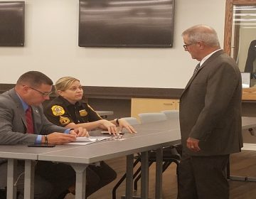 Det. Brian Shahan, M/Cpl., Heather Carter and Glenn Davis discuss New Castle County Cold Case Squad. (Andrea Gibbs/WHYY)