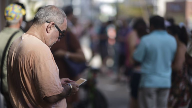 A man stands at a Wi-Fi hotspot in the aftermath of Hurricane Maria with many cellphone towers down in San Juan, Puerto Rico, Sunday, Sept. 24, 2017. (Carlos Giusti/AP Photo)