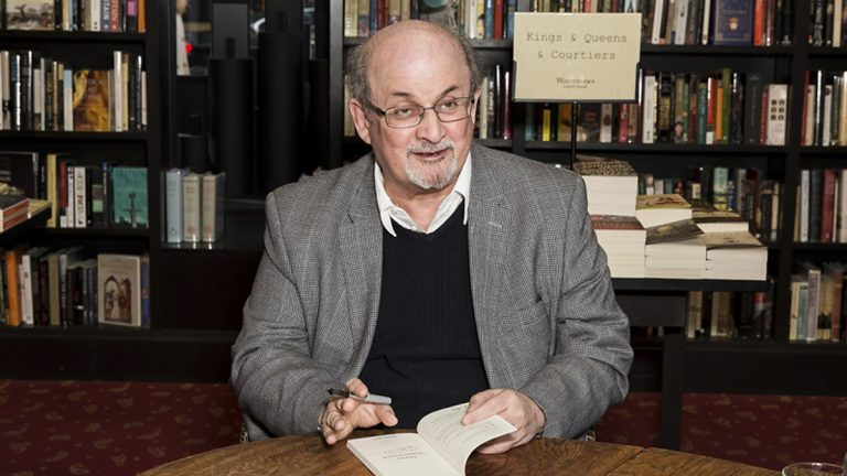 Author Salman Rushdie poses for photographers at a book signing in London, Tuesday, June 6, 2017. (Grant Pollard/Invision/AP)