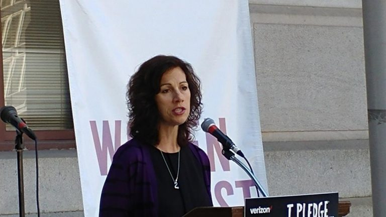 Jeannine Lisitski, executive director of Women Against Abuse, says women are not the only targets of abuse. (Tom MacDonald/WHYY)