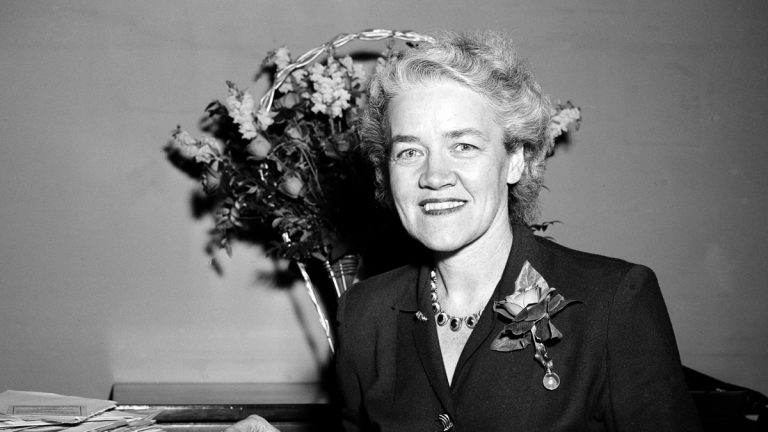 Sen. Margaret Chase Smith, R-Me., smiles Jan., 5, 1949, as she takes a break from looking over papers in her office in Washington D.C.