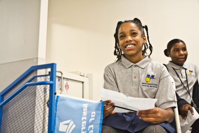 4th grade Mastery Cramer Hill Elementary student Anali Mitchell read her dreams for a better future before putting them into the time capsule. (Kimberly Paynter/WHYY)