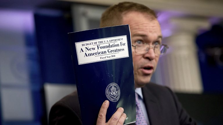 Budget Director Mick Mulvaney holds up a copy of President Donald Trump's proposed fiscal 2018 federal budget. His $4.1 trillion plan for the budget year beginning Oct. 1 generally proposes deep cuts in safety net programs, including Medicaid and the Children's Health Insurance Program.