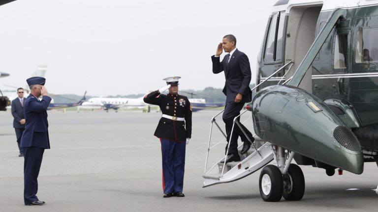 President Barack Obama salutes as he steps off of Marine One, at Dover Air Force Base, Del., Tuesday, Aug. 9, 2011, before meeting privately with families of 30 Americans killed in an International Security Assistance Force helicopter crash in eastern Afghanistan.