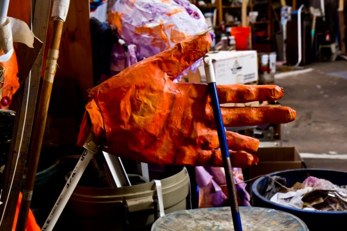Giant puppet hands at the Spiral Q warehouse in West Philadelphia. (Kimberly Paynter/WHYY)