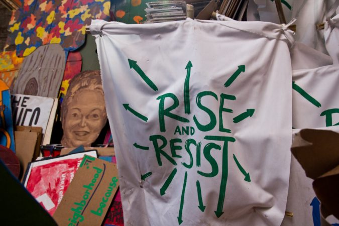Banners that will be carried by community members at the Peoplehood Parade Saturday. (Kimberly Paynter/WHYY)