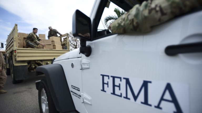 Department of Homeland Security personnel deliver supplies to Santa Ana community residents in the aftermath of Hurricane Maria in Guayama, Puerto Rico.