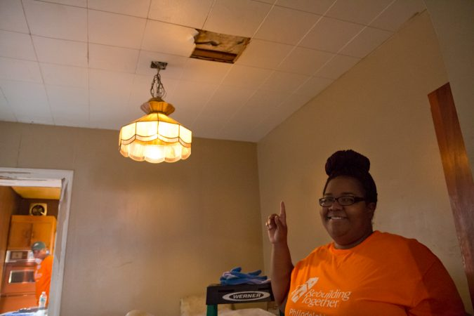 Homeowner Elander Liles is working on her home along with the help of Rebuilding Together Philadelphia. (Kimberly Paynter/WHYY)