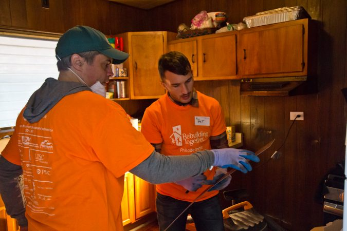 Rebuilding Together Philadelphia organized volunteers to renovate homes on the 1900 block of Somerset in Philadelphia's Kensington neighborhood. (Kimberly Paynter/WHYY)