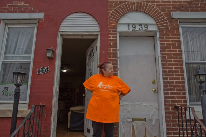 Homeowner Lucy Lopez's home on Somerset Street is being renovated by volunteers from Rebuilding Together Philadelphia. (Kimberly Paynter/WHYY)