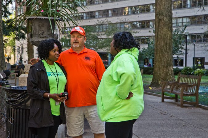 Ashley Cotton (left), Wes Lilly (center) and Sherika Morgan (right), reach out to the homeless in Rittenhouse Square Park.