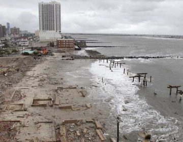 Foundations and pilings are all that remain of brick buildings and a boardwalk in Atlantic City, N.J., Tuesday, Oct. 30, 2012, after they were destroyed when a powerful storm that started out as Hurricane Sandy made landfall on the East Coast on Monday night. (AP Photo/Seth Wenig)