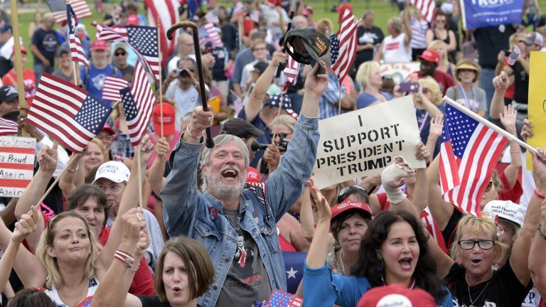 People gather on the National Mall in Washington, Saturday, Sept. 16, 2017, to attend a rally in support of President Donald Trump.