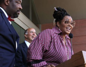 Jill Scott, a Philadelphia native and a three-time Grammy Award-winning singer-songwriter, is honored with a plaque on the Philadelphia Music Walk of Fame during a ceremony outside the Kimmel Center. (Emma Lee/WHYY)