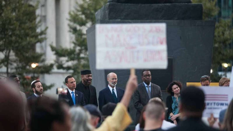 Elected officials and religous leaders stood at a vigil Tuesday in Philadelphia honoring the victims of Sunday night's mass shooting in Las Vegas.