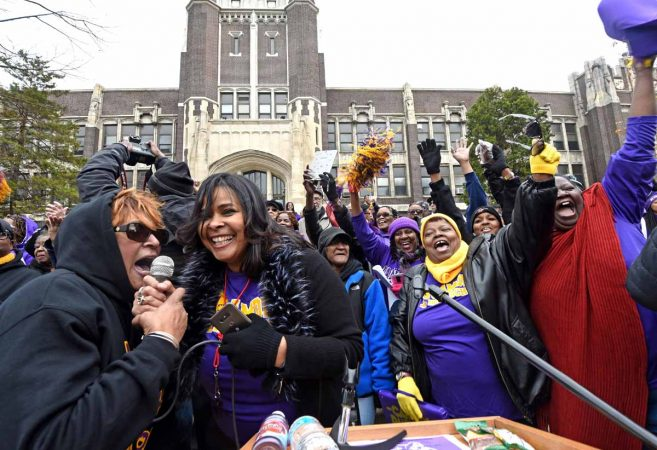 At a block party in November 2016 to celebrate Camden High, alumni greet others over a microphone.  Carmen Lozada, second from left, helped organize the event as an officer of the Camden High Alumni Association, (April Saul/for Newsworks)