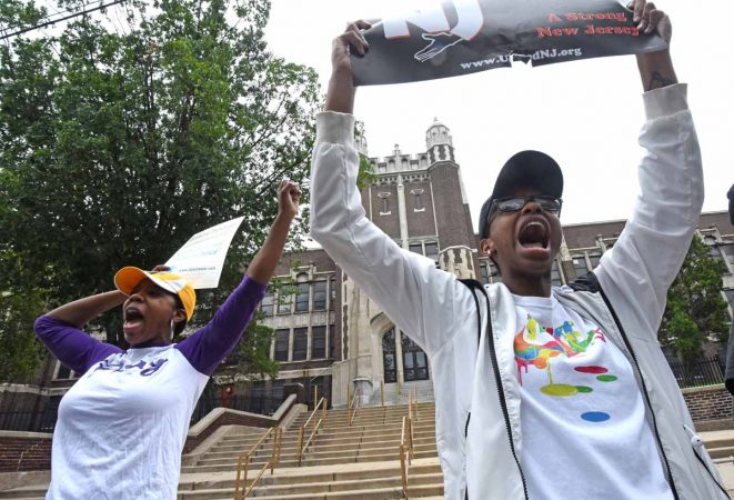 Activists demonstrate in front of Camden High to save the school in July 2017. (April Saul/for Newsworks)