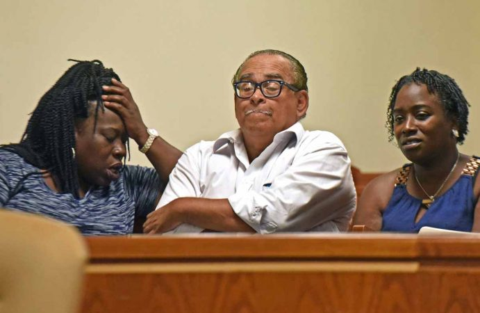 From left to right, Camden community activists Vida Neil, Stan White and Moneke Singleton-Ragsdale react to an August 2016 court decision that failed to help restore an elected board of education to their city. (April Saul/for Newsworks)