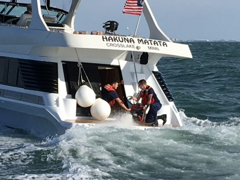 U.S. Coast Guard crew members help dewater a vessel off Cape May on Wednesday. (Photo courtesy of the USCG)