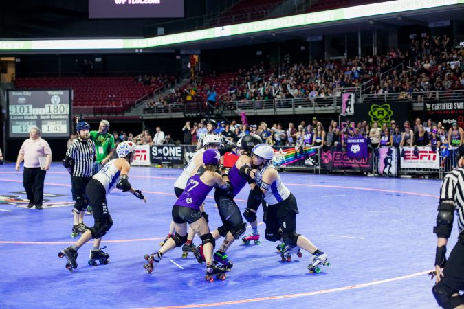 The Rose City Rollers of Portland, Oregon, face off against the Victorian Roller Derby League from Melbourne, Australia, in the championship game at the WFTDA International Championships at the Liacouras Center. (Brad Larrison for WHYY)