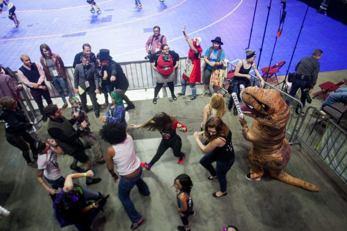 Roller derby fans dance between games at the WFTDA International Championship at the Liacouras Center. (Brad Larrison for WHYY)