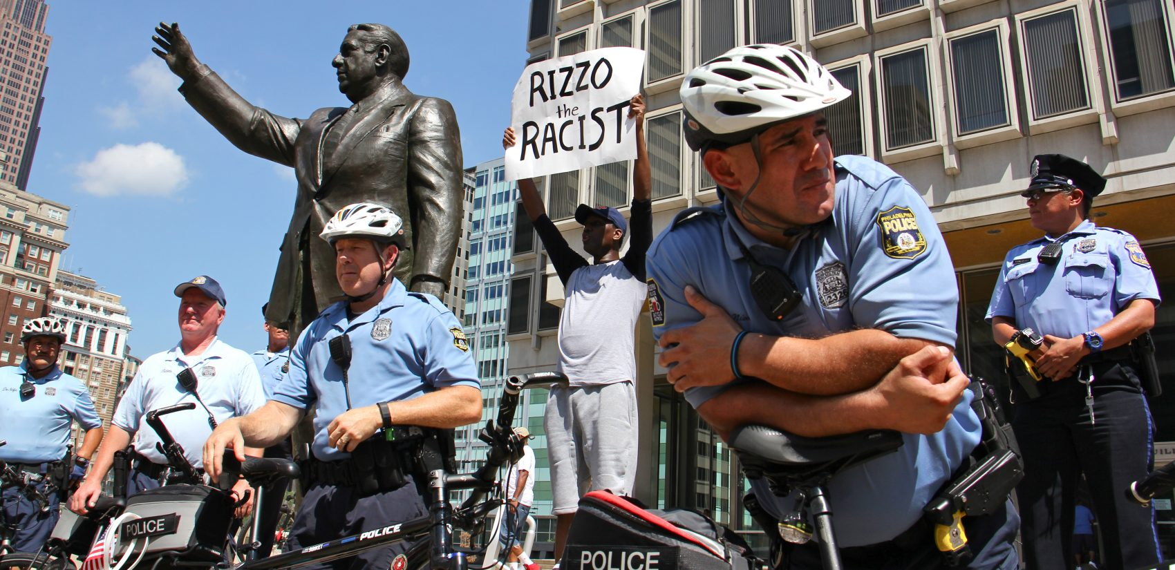 Philadelphia police protect the Frank Rizzo statue during a protest